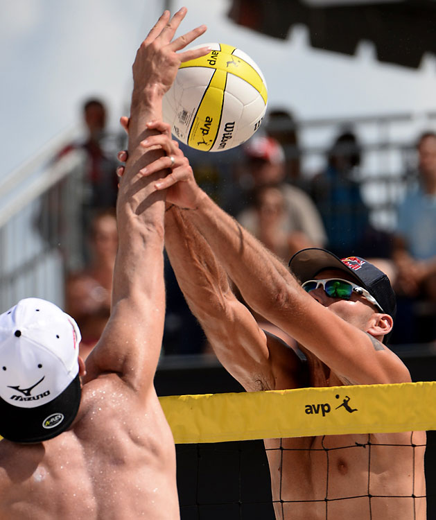 Phil Dalhausser does all he can to keep a ball from coming over to his side of the net.