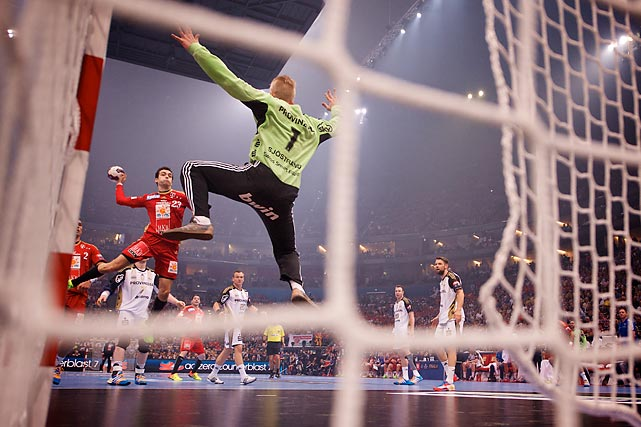 Cristina Ugalde Garcia from MKB MVM Veszprem (Hungary) scores vs. Johan Sjostrand from THW Kiel (Germany) in EHF Champions League semifinal match on May 31.