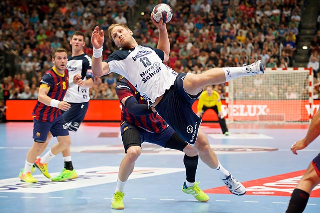 Steffen Weinhold (13) from SG Flensburg-Handewitt attempts to score in EHF Champions League semifinal vs. FC Barcelona on May 31.