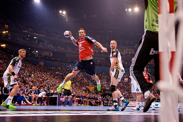 Thomas Mogensen (10) from SG Flensburg-Handewitt attempts to score vs. Johan Sjostrand from THW Kiel in the EHF Champions League Final.