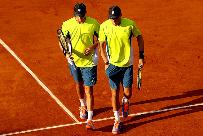 No. 1 seeds Bob and Mike Bryan were dominated by Spaniards Marcel Granollers and Mark Lopez.