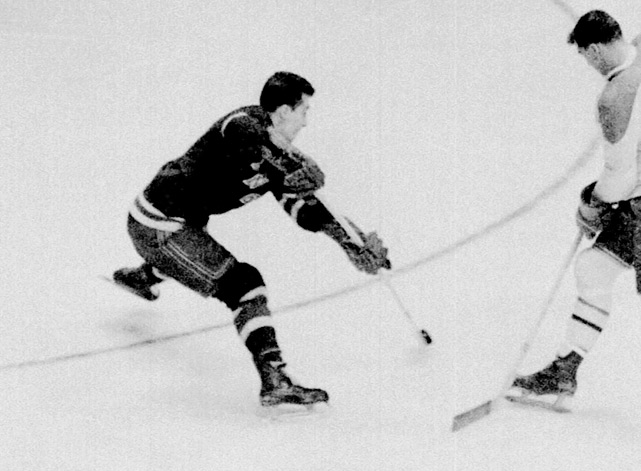 "A three-time All-Star, Henry produced eight 20-goal seasons during the 1950s and 60s with the Rangers and served as captain after Andy Bathgate was traded in 1964. Henry always played above and beyond his size (5'7"", 152 pounds), which was tiny even by the standards of the day. He won the Calder Trophy as rookie of the year for 1953-54, and the Lady Byng Trophy in 1957-58."