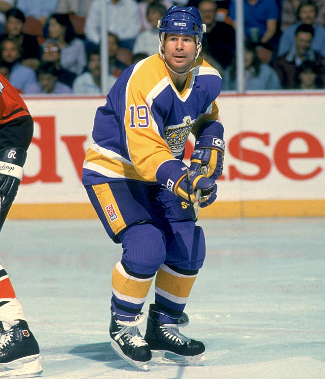 "Chosen by the Kings in the first-round (10th overall) of the 1980 draft, the speedy 5'-8"", 185-pound winger spent all nine of his NHL seasons with the Kings (1980-90), reaching the 30-goal mark three times. The highlight of his five playoff appearances was the Miracle on Manchester first round upset of Wayne Gretzky's Oilers in 1982. Back and hip woes cost Fox half of the 1985-86 season, and a knee injury sidelined him for all of 1988-89, ultimately ending his career. He went on to become the team's community relations director and developer of the Kings Care Foundation as well as L.A.'s long-time TV color analyst. Fox was honored with a Legends Night Ceremony at Staples Center in March 2014."