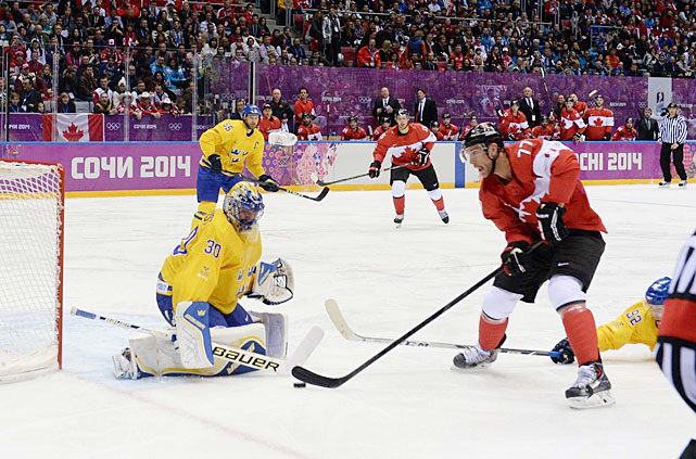 The Kings sent six players to Sochi, including center Anze Kopitar, whose home nation Slovenia made its first Olympic appearance. Defenseman Slava Voynov represented host country Russia and played a memorable game against American teammates Jonathan Quick and Dustin Brown. But Kings forward Jeff Carter (right) and defenseman Drew Doughty were the ones who came back with the ultimate prize: gold medals from Team Canada's dominating performance against Henrik Lundqvist (left) and Team Sweden. Lundqvist and his Rangers would later be waiting for them in the Stanley Cup Final.