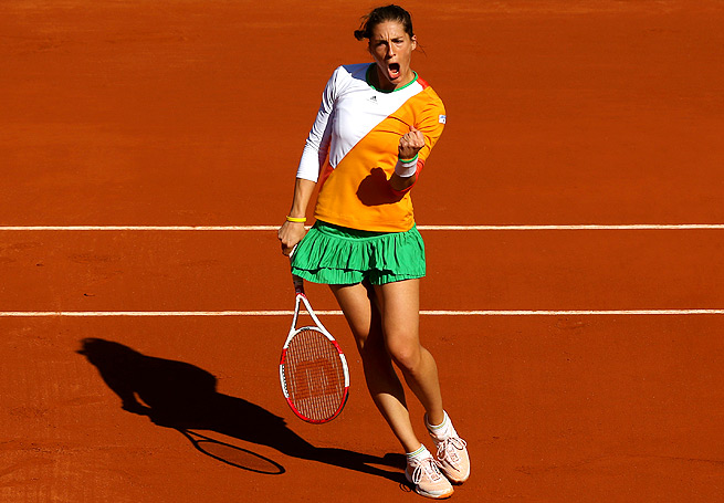 Andrea Petkovic defeated Sara Errani to reach her first-ever Grand Slam semifinals at Roland Garros.