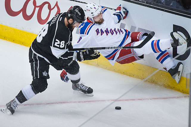 Jarret Stoll of the Los Angeles Kings checks Kevin Klein of the New York Rangers into the boards