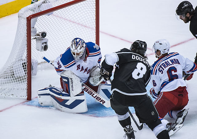 Kings defenseman Drew Doughty scores the game-tying goal past Rangers goalie Henrik Lundqvist in the second period.