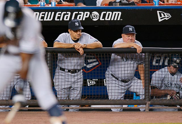 Torre and Zimmer watch carefully as the Yankees take on the Mets.