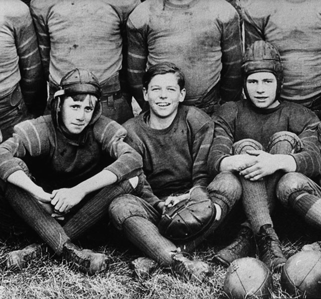 Reagan poses with his high school football team in Dixon, Ill.