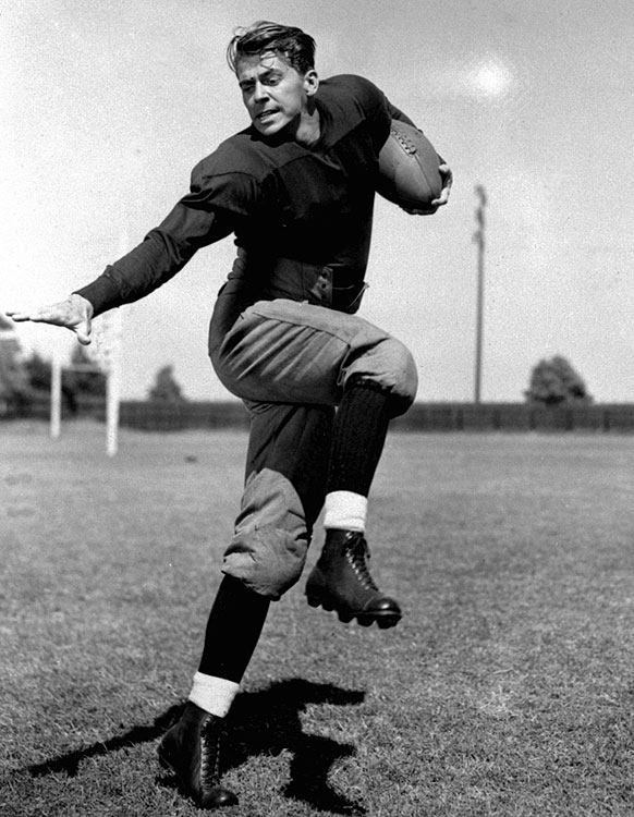Reagan poses as Notre Dame football star George Gipp, whom Reagan played in the 1940 film <italics>Knute Rockne All American</italics>.