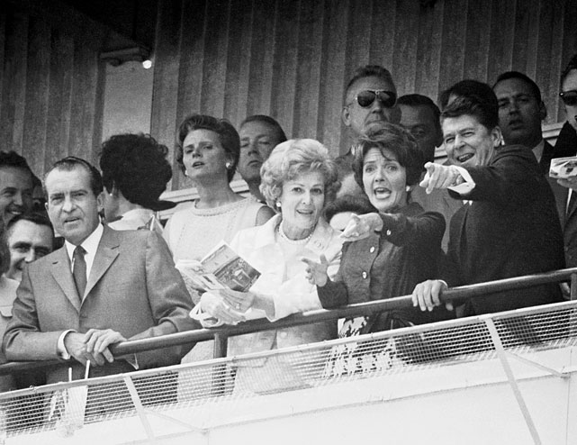 California Governor Ronald Reagan and his wife Nancy excitedly follow the progress of a horse running in the sixth race of the Kentucky Derby program alongside President Richard Nixon and his wife, Pat, at Churchill Downs in Louisville, Ky.
