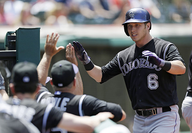 With Carlos Gonzalez on the DL, Corey Dickerson (right) should get a chance to stand out in the Rockies' loaded lineup.