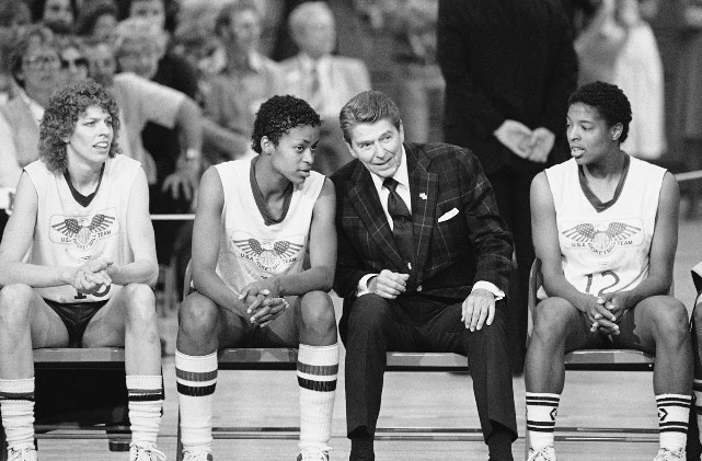 U.S. Olympic basketball player Pam Magee of USC talks with President Reagan during his visit to the U.S. Olympic Training Center in Colorado Springs.