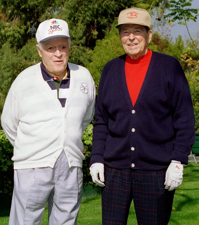 Former President Reagan poses with Bob Hope before an afternoon of golf on Reagan's 84th birthday.