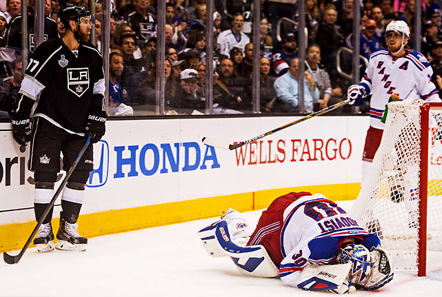 In the first overtime, Jeff Carter got called for slashing Henrik Lundqvist while chasing the puck on the forecheck.
