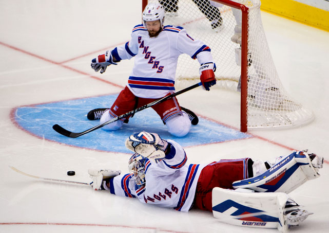 Henrik Lundqvist and defenseman Kevin Klein attempt to stop a shot by Jarret Stoll.