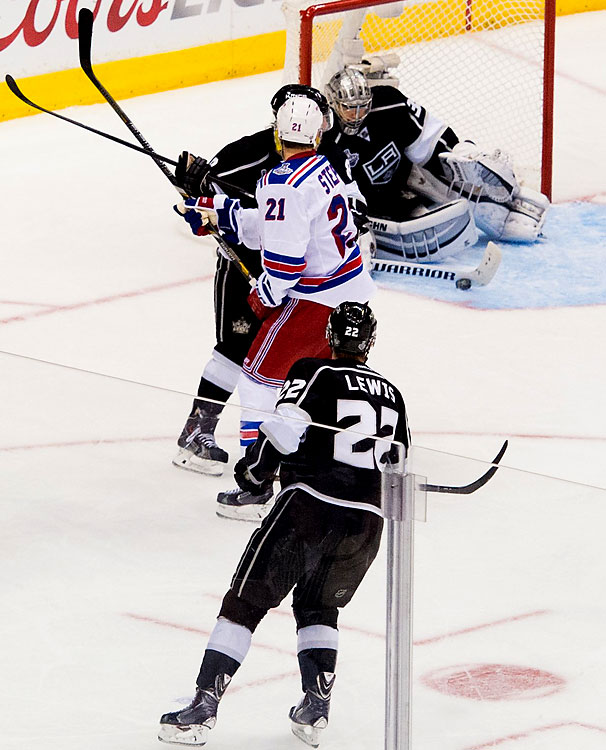 Jonathan Quick makes a stick save. He stopped 34 shots on the night.