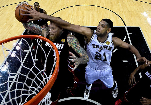Miami's Chris Anderson tries to finish against Tim Duncan. Anderson finished with three points; Duncan with one block.