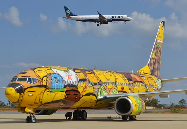 The plane truth: This snazzy Gol airlines Boeing 737-800 will ferry Brazil's national team across the country during the FIFA World Cup. Its distinctive design was painted by graffiti artists and identical twin brothers Otavio and Gustavo Pandolfo, presumably while no one was looking.