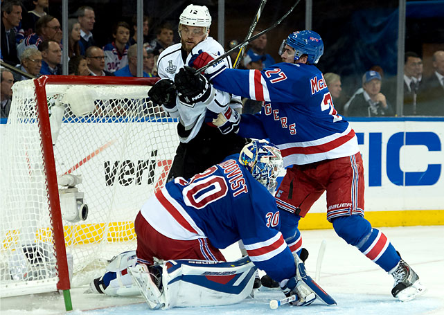 Marian Gaborik of the Kings is checked into the net by Ryan McDonagh. Gaborik played his first game at the Garden since being traded by the Rangers in 2013.