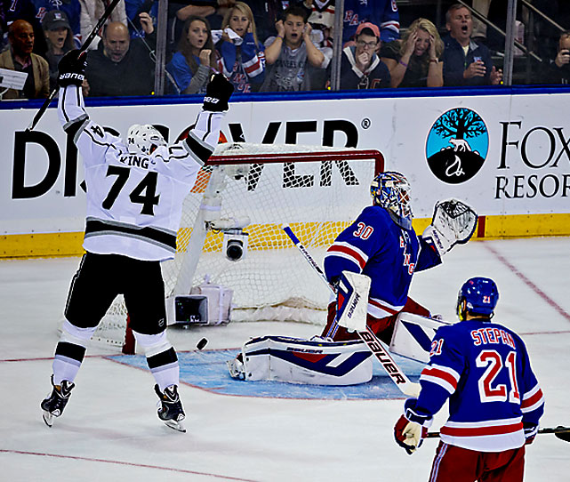 Dwight King celebrates Jeff Carter's score while the Rangers' crowd reacts painfully. Defenseman Jake Muzzin scored a power-play goal in the second period to give L.A. a 2-0 lead. Read More: http://sportsillustrated.cnn.com/hockey/nhl/gameflash/2014/06/09/34813_recap.html#ixzz34D04FLaU