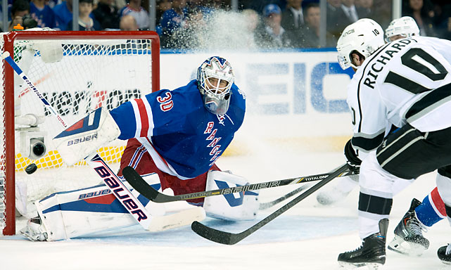 SI's best photos from Game 3 of the Stanley Cup, in which the Los Angeles Kings moved to within one victory of sweeping the New York Rangers. The Kings took a 3-0 lead on this Mike Richards' shot in the second period against Henrik Lundqvist.