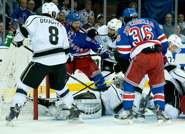 Drew Doughty (8) and Mats Zuccarello (36) jockey for position around goaltender Jonathan Quick.