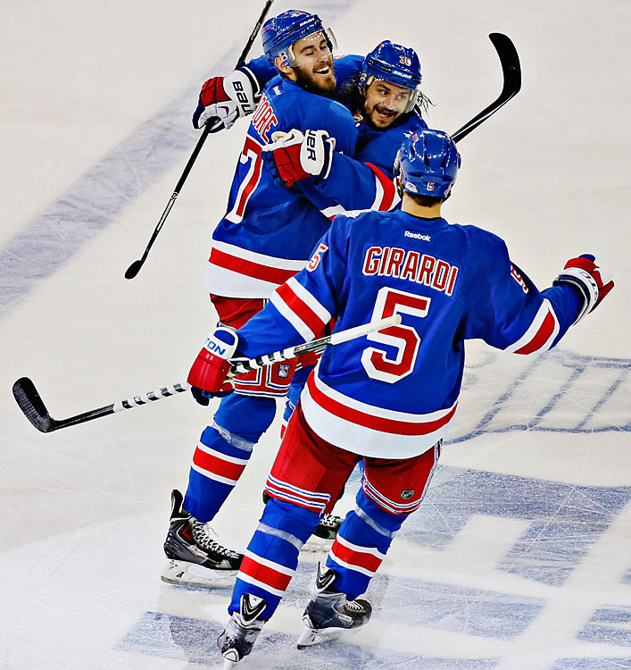 John Moore (17), Mats Zuccarello (36) and Dan Girardi (5) celebrate during a Game 4 win in which the Rangers staved off elimination from the Stanley Cup Final.