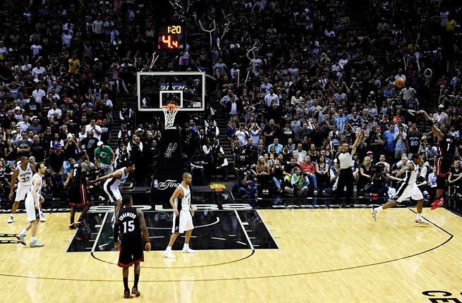 Chris Bosh's corner three-pointer gave the Heat the lead for good late in Game 2 of the NBA Finals.