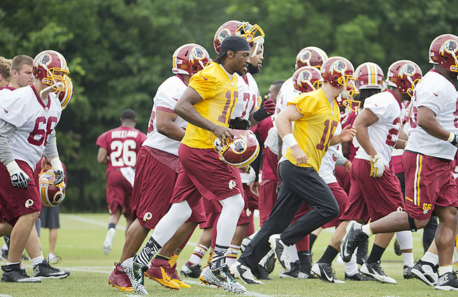 Robert Griffin III (center) has looked strong in offseason workouts after a serious knee injury loomed over his 2013 campaign.