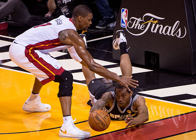 Kawhi Leonard hustles to keep the ball out of Chris Bosh's hands. In Game 4, Miami seemed to lack the energy -- or maybe effort -- to defend San Antonio's precision ball movement for the full 24 seconds.