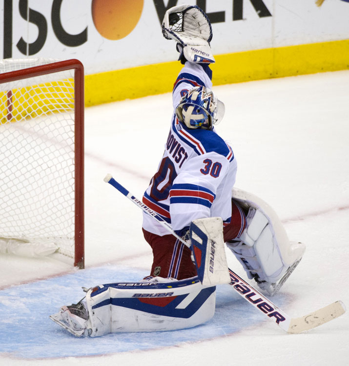 Henrik Lundqvist makes a glove save.