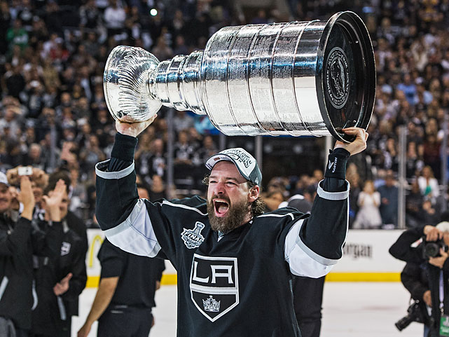 Conn Smythe Trophy winner Justin Williams raises the Stanley Cup.