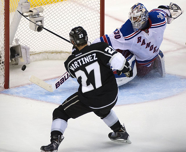Alec Martinez scored 14:43 into the second overtime, and the Kings won the Stanley Cup for the second time in three years with their 3-2 victory.