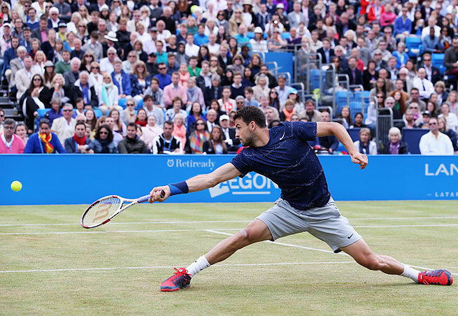 Grigor Dimitrov survived a second-set match point to defeat Feliciano Lopez at Queen's Club on Sunday.
