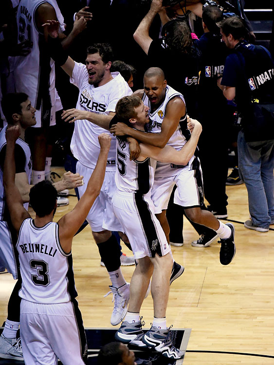 Patty Mills leaps into Matt Bonner's arms after the Spurs' win. Mills scored 17 points, sinking five of eight three-point attempts.