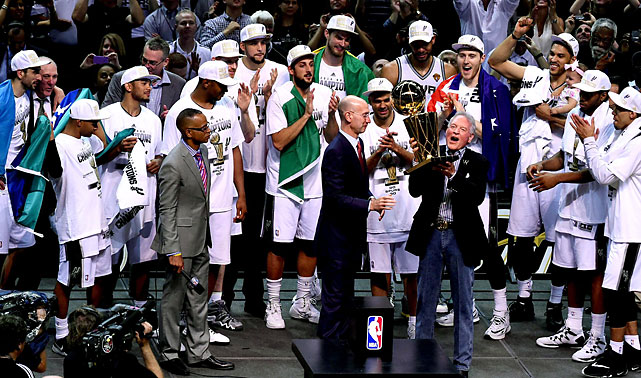 Spurs owner Peter Holt accepts the Larry O'Brien trophy from NBA commissioner Adam Silver.