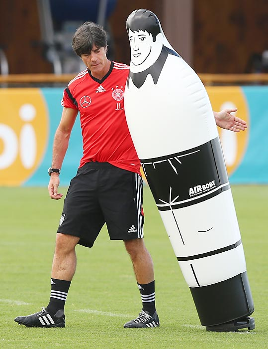 Inflated hopes: Head coach Joachim Loew works with the German National team's new midfielder during a brisk training session at Campo Bahia in Santo Andre, Brazil.