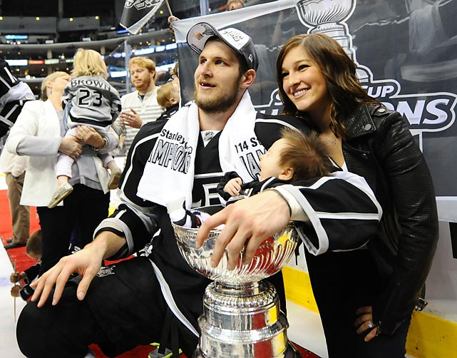Kings wing Kyle planted his son Brody in Lord Stanley's hallowed baby bath as girlfriend Paige Gugulyn proudly looked on during the gala postgame celebration at Staples Center in Los Angeles