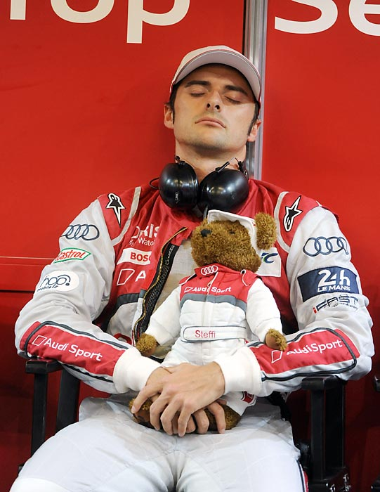 There was apparently very little endurance in the big endurance race in Western France this year. Here we have Marco Bonanomi of the Audi R18 E-Tron Quattro Hybrid N-3 team copping some Zs with his co-pilot, Ted.