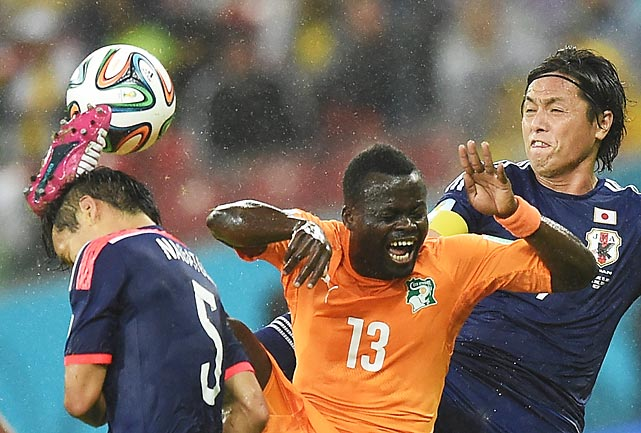 Ivory Coast's Didier Ya Konan vies for the ball with Japan's Yasuhito Endo (right) during the teams' first match of the World Cup, an eventual 1-1 draw.