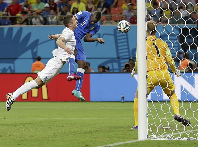 Italy's Mario Balotelli heads the ball past England's Joe Hart to score his side's second goal of the match.