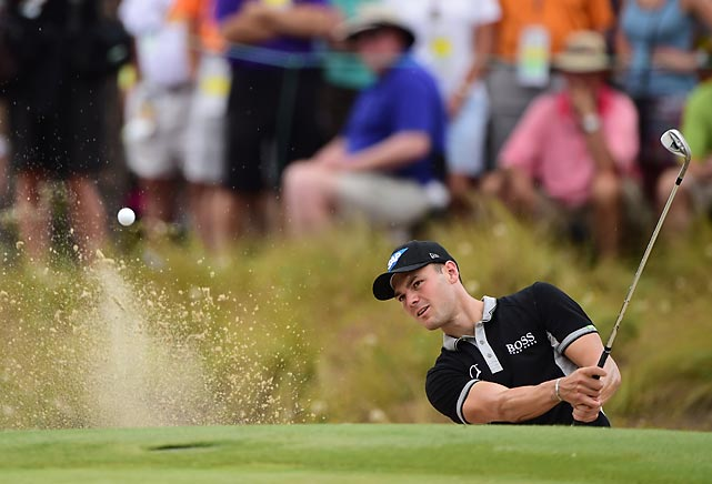Martin Kaymer chips one out of a bunker in round 2 of the U.S. Open. He held a six-stroke lead after the tournament's first two days, setting a record by shooting -10 and becoming the first player ever to shoot 65 or better in the first two rounds of a major. His strong play all but sealed his eventual win.