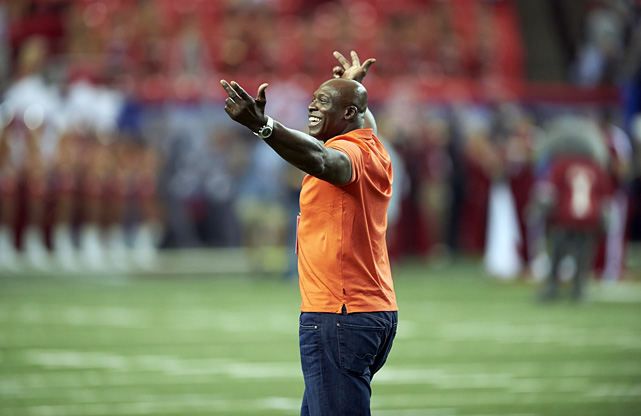 Smith acknowledges the crowd while on the field before his alma mater, Virginia Tech, takes on Alabama in the Chick-fil-A Kickoff Game at the Georgia Dome in Atlanta.