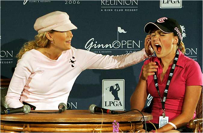 Dakoda may be the golfing phenom, but she's still mommy's little girl, as Kelly Jo gets something out of her daughter's eye during a news conference before the Ginn Open.