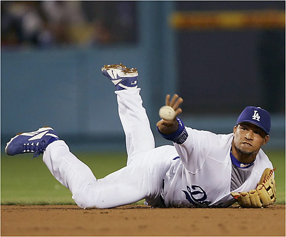 New Dodgers shortstop Rafael Furcal makes a throw from his belly to get a forceout on April 5.