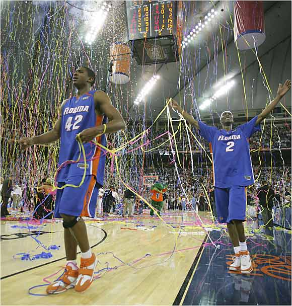 Corey Brewer and Al Horford celebrate a rout of the Bruins and Florida's first title.