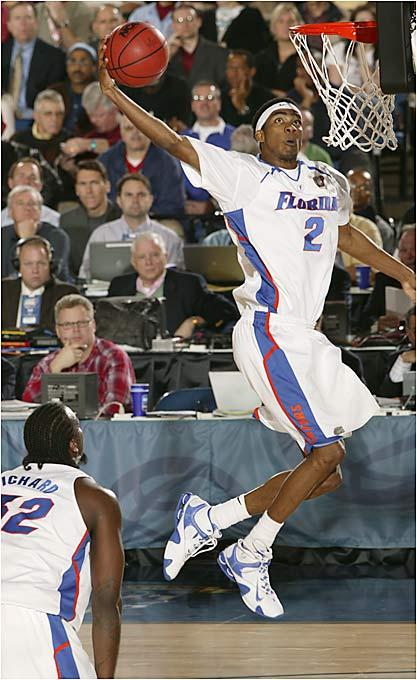Sophomore guard Corey Brewer finishes off a fast break for the Gators.