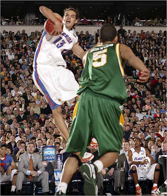 The Gators' 6-foot-11 Joakim Noah grabs one of his seven rebounds in the first half.