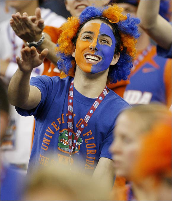 A Florida fan cheers on his Gators.
